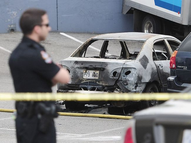 vancouver-bc-may-24-2016-a-burnt-out-car-sits-in-the.jpg