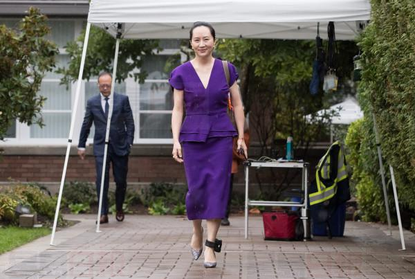 Huawei chief financial officer Meng Wanzhou, who is out on bail and remains under partial house arrest after she was detained last year at the behest of American authorities, wears an electronic monitoring bracelet on her ankle as she leaves her home to attend a court hearing in Vancouver, on Monday September 23, 2019. THE CANADIAN PRESS/Darryl Dyck