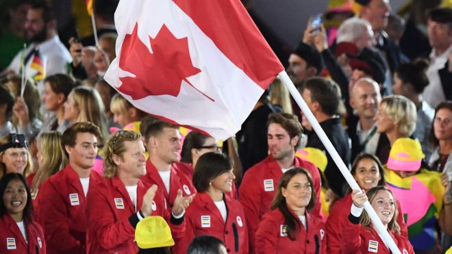 Canada's flag bearer Rosannagh Maclennan leads her national delegation during the opening ceremony of the Rio 2016 Olympic Games at the Maracana stadium in Rio de Janeiro on August 5, 2016