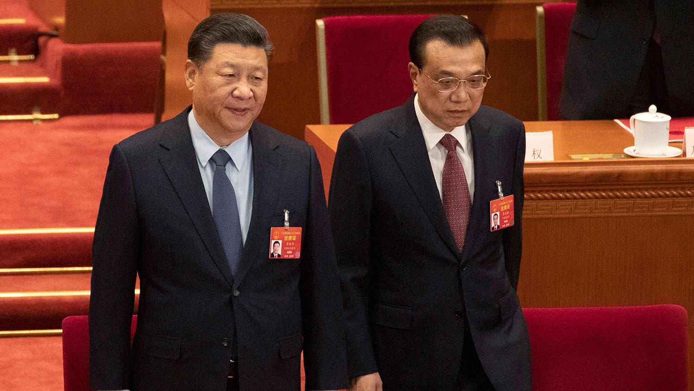 2019年3月15日,中共十三届全国人大二次会议在北京闭幕。图为习近平与李克强。(美联社)
