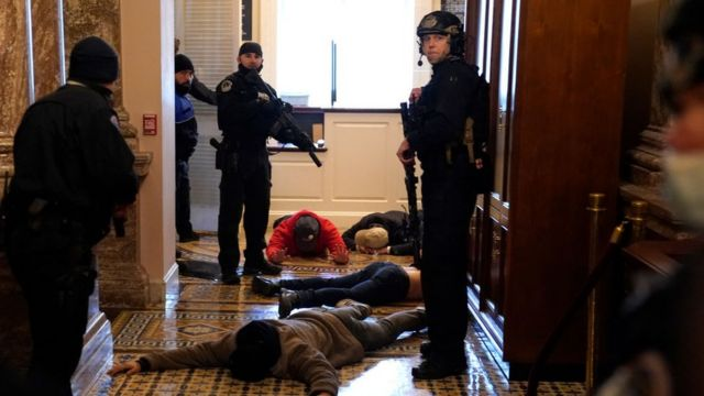 Capitol police detain protesters inside the building