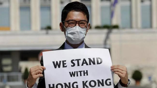 香港青年领袖罗冠聪获英国庇护