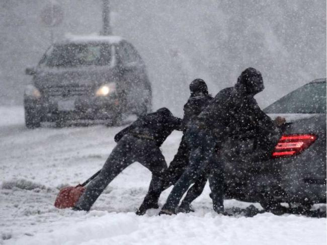 burnaby-bc-december-5-2016-people-push-a-car-during-a.jpeg
