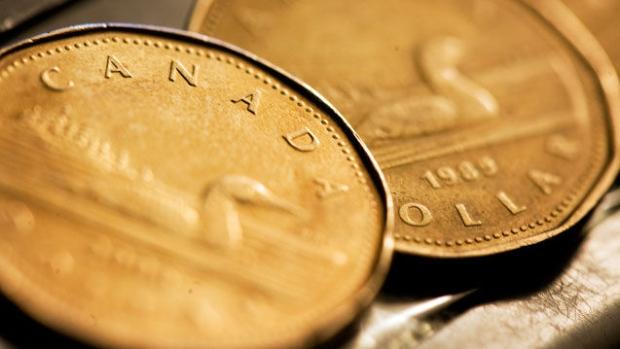 经济强劲央行加息 加元反弹冲破80美分关口