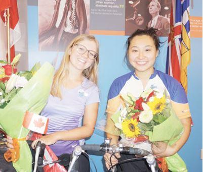 本拿比华裔女生骑单车横穿优发国际 支持反输油计划